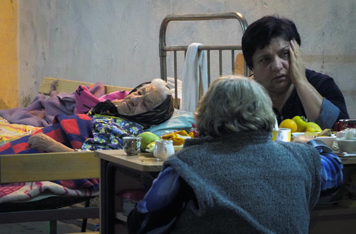 Women take refuge in a bomb shelter in Stepanakert, the separatist region of Nagorno-Karabakh, Tuesday, Nov. 3, 2020. Fighting over the separatist territory of Nagorno-Karabakh entered sixth week on Sunday, with Armenian and Azerbaijani forces blaming each other for new attacks. (AP Photo)