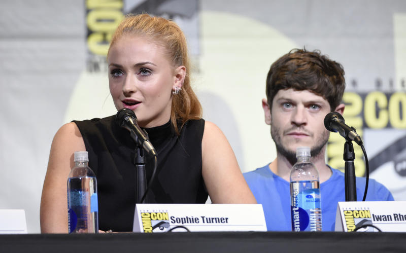 "Sophie Turner, left, and Iwan Rheon attend the ""Game of Thrones"" panel on day 2 of Comic-Con International on Friday, July 22, 2016, in San Diego. (Photo by Chris Pizzello/Invision/AP)"