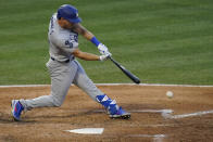 Los Angeles Dodgers' Austin Barnes (15) singles on a ground ball to Los Angeles Angels second baseman David Fletcher during the fourth inning of a baseball game Saturday, May 8, 2021, in Anaheim, Calif. Chris Taylor scored. (AP Photo/Ashley Landis)