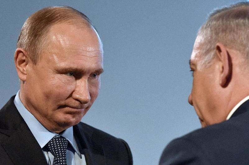 Russian President Vladimir Putin (L) and Israeli Prime Minister Benjamin Netanyahu attend an event marking International Holocaust Victims Remembrance Day and the anniversary of the complete lifting of the Nazi siege of Leningrad