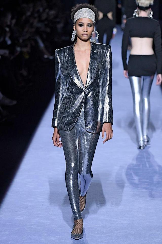 <p>Model wears a silver sequined metallic pantsuit at the fall 2018 Tom Ford show. (Photo: Getty Images) </p>