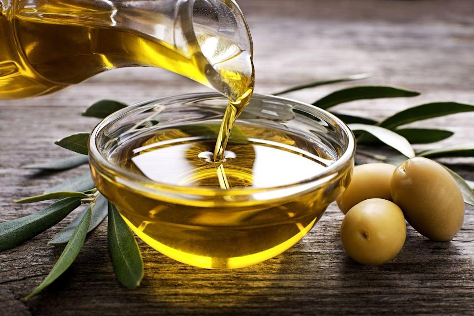 """<p>Olive oil is packed with heart-healthy monounsaturated fats (MUFAs), which help lower """"bad"""" LDL cholesterol and raise """"good"""" HDL cholesterol. It's rich in antioxidants that can help reduce the risk of cancer and other chronic diseases, like Alzheimer's. Look for extra-virgin oils for the most antioxidants and flavor. Drizzle small amounts on veggies before roasting; use it to sauté or stir-fry, in dressings and marinades, and to flavor bread at dinner in lieu of a layer of butter or margarine.</p><p><strong>Try it: </strong><a href=""""https://www.prevention.com/food-nutrition/recipes/a25670258/baked-halibut-recipe/"""" rel=""""nofollow noopener"""" target=""""_blank"""" data-ylk=""""slk:Baked Halibut With Roasted Potatoes and Brussels Sprouts"""" class=""""link rapid-noclick-resp"""">Baked Halibut With Roasted Potatoes and Brussels Sprouts</a></p>"""