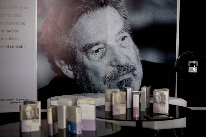 "A photo of Mexican Nobel Prize poet and essayist Octavio Paz and some of his books are on exhibit marking the 100th anniversary of his birth in Mexico City, Monday, March 31, 2014. Mexico's government and top poets are holding readings and exhibitions to remember Paz, whose most famous work was the 1950 essay ""The Labyrinth of Solitude."" Paz died 16 years ago. (AP Photo/Eduardo Verdugo)"