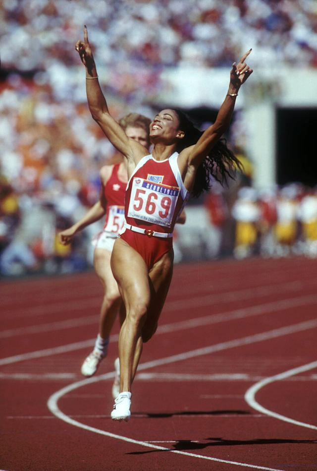 Sep 1988: Florence Griffith-Joyner of the USA celebrates after winning the 100m meter final at the 1988 Seoul Summer Olympics in Seoul, South Korea. Griffith-Joyner won the race with an Olympic record time of 10.54. Mandatory Credit: Mike Powell/Allsp
