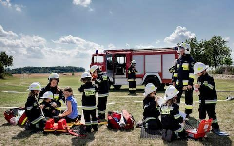 <span>The all-girl young volunteer firefighters team in the village of Miejsce Odrzanskie, Poland,</span> <span>Credit: Kasia Strek/NYTNS / Redux / eyevine </span>