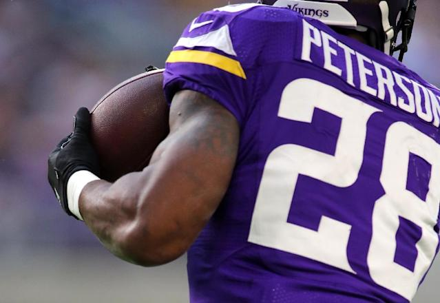 Adrian Peterson leaves the Minnesota Vikings as one of the best players in club history (AFP Photo/Adam Bettcher)
