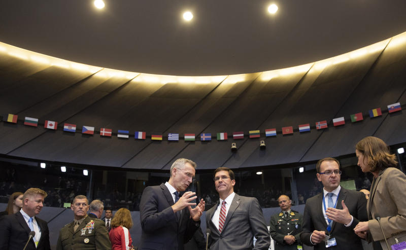 NATO Secretary General Jens Stoltenberg, left, and acting U.S. Secretary for Defense Mark Esper chair a meeting of the coalition to defeat Islamic State militants at NATO headquarters in Brussels, Thursday, June 27, 2019. (AP Photo/Virginia Mayo, Pool)