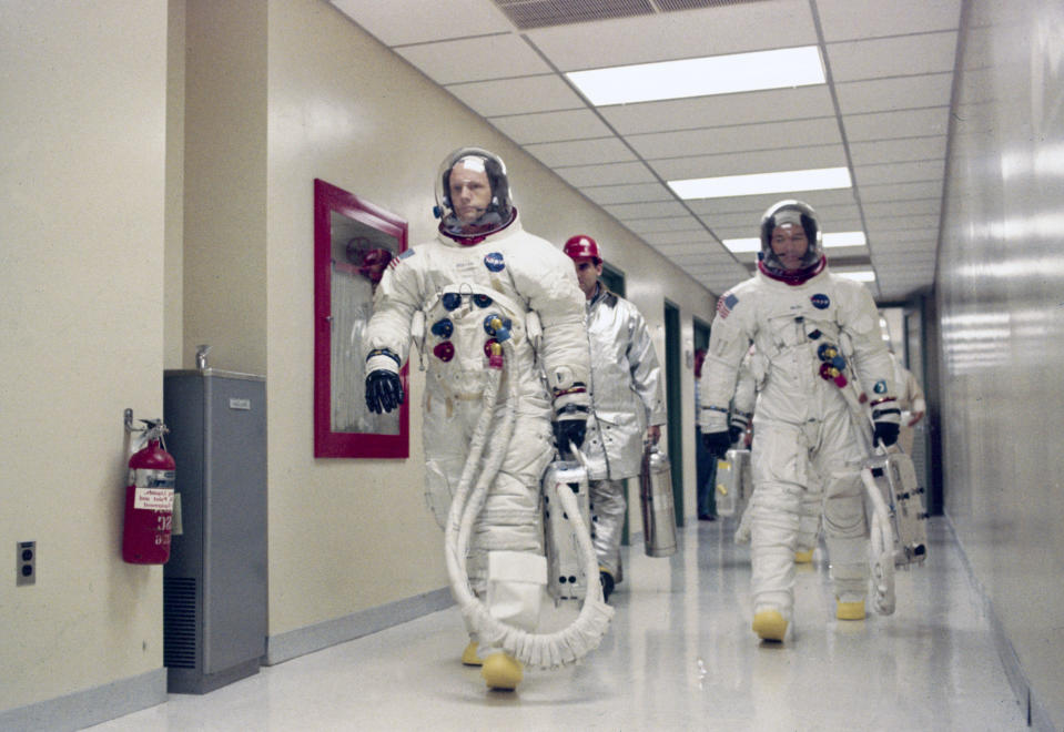"""Apollo 11 Commander Neil Armstrong leading Michael Collins and Edwin """"Buzz"""" Aldrin (hidden behind Collins) down a corridor on their way to participate in the launch countdown demonstration test on July 15, 1969.  (Photo: SSPL/Getty Images)"""
