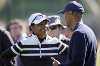 Former Secretary of State Condoleezza Rice, left, talks to Tiger Woods on the 17th hole during the Genesis Invitational pro-am golf event at Riviera Country Club, Wednesday, Feb. 12, 2020, in the Pacific Palisades area of Los Angeles. (AP Photo/Ryan Kang)