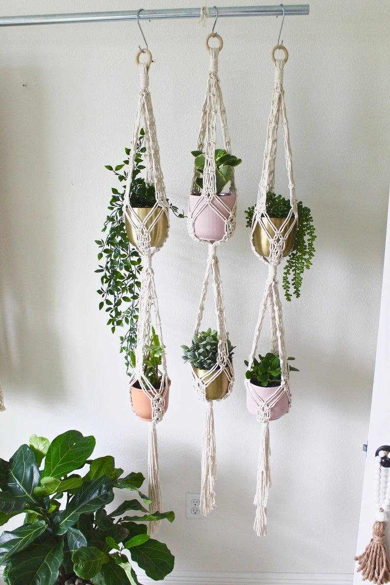 "<br><br><strong>Larksandleo</strong> Double Macrame Plant Hanger, $, available at <a href=""https://go.skimresources.com/?id=30283X879131&url=https%3A%2F%2Fwww.etsy.com%2Flisting%2F706808784%2Fdouble-macrame-plant-hanger-large"" rel=""nofollow noopener"" target=""_blank"" data-ylk=""slk:Etsy"" class=""link rapid-noclick-resp"">Etsy</a>"