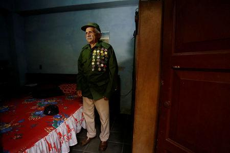 Former rebel  Julio Lopez, 77, poses for a photo in his home in Santa Clara, Cuba, March 10, 2018. REUTERS/Stringer