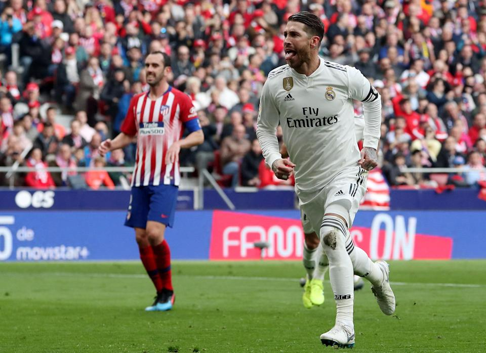 Real Madrid's Sergio Ramos (right) scored a goal and added an assist in Saturday's derby against city rival Atletico Madrid. (Reuters/Susana Vera)