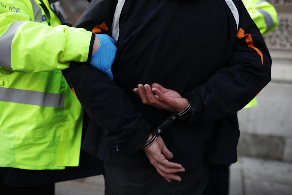 LONDON, ENGLAND - JANUARY 06: An anti-lockdown protester is arrested by police officers in Parliament Square outside the House of Commons on January 6, 2021 in London, England. The UK Parliament has been recalled today to debate and vote on the new regulations needed to reimpose the England-wide lockdown that was announced by Prime Minister Boris Johnson on Monday night. (Photo by Dan Kitwood/Getty Images)