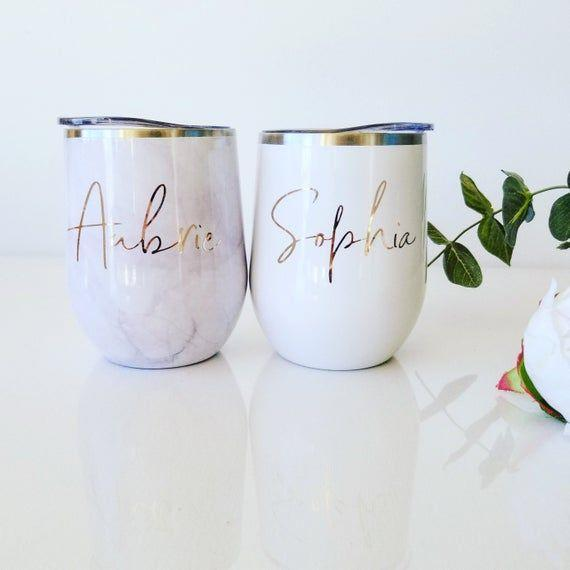 """<p><strong>PaolaBrownShop</strong></p><p>etsy.com</p><p><strong>$17.00</strong></p><p><a href=""""https://go.redirectingat.com?id=74968X1596630&url=https%3A%2F%2Fwww.etsy.com%2Fie%2Flisting%2F655066985%2Fwine-tumbler-marble-tumbler-custom-wine&sref=https%3A%2F%2Fwww.cosmopolitan.com%2Flifestyle%2Fg31699444%2Fgemini-gift-guide%2F"""" rel=""""nofollow noopener"""" target=""""_blank"""" data-ylk=""""slk:Shop Now"""" class=""""link rapid-noclick-resp"""">Shop Now</a></p><p>Any customized item will definitely have you winning Gift of the Year. There's nothing Geminis like more than feeling special and cared for. Splashing their name on something they'll love will certainly do the trick.</p>"""