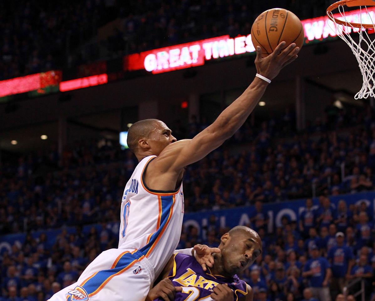 OKLAHOMA CITY, OK - MAY 21:  Russell Westbrook #0 of the Oklahoma City Thunder goes up for a shot over Kobe Bryant #24 of the Los Angeles Lakers in the first quarter during Game Five of the Western Conference Semifinals of the 2012 NBA Playoffs at Chesapeake Energy Arena on May 21, 2012 in Oklahoma City, Oklahoma.  NOTE TO USER: User expressly acknowledges and agrees that, by downloading and or using this photograph, User is consenting to the terms and conditions of the Getty Images License Agreement.  (Photo by Ronald Martinez/Getty Images)