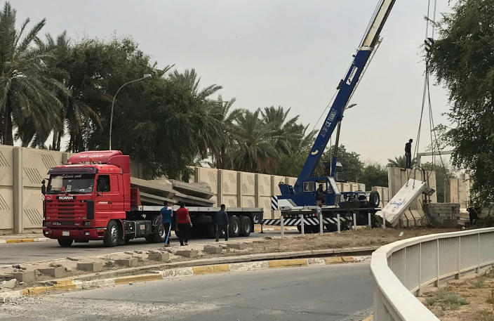 "In this Tuesday, May 28, 2019 photo, Iraqi security forces remove concrete blast walls at the Green Zone in Baghdad, Iraq. The Green Zone has been a barometer for tension and conflict in Iraq for nearly two decades. The 4-square mile (10-square kilometer), heavily guarded strip on the Tigris River was known as ""Little America"" following the 2003 U.S.-led invasion that toppled dictator Saddam Hussein. It then became a hated symbol of the country's inequality, fueling the perception among Iraqis that their government is out of touch. (AP Photo/Ali Abdul Hassan)"