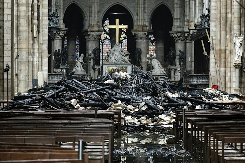 The cathedral spire and much of the wooden roof was destroyed in the blaze (AFP Photo/LUDOVIC MARIN)