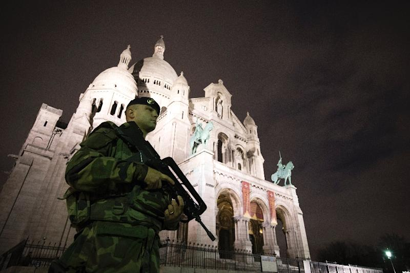 A French soldier stands guard in front of the Sacre Coeur Basilica on November 16, 2015 in Paris, three days after a series of deadly coordinated attacks claimed by Islamic State jihadists killed 129 people