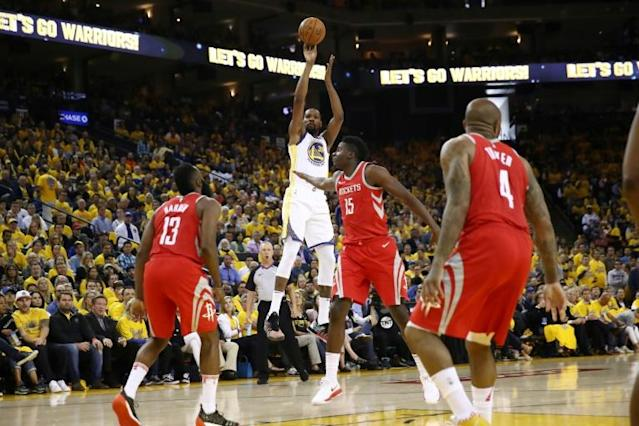 Kevin Durant of the Golden State Warriors takes a shot against the Houston Rockets during game three of the Western Conference Finals