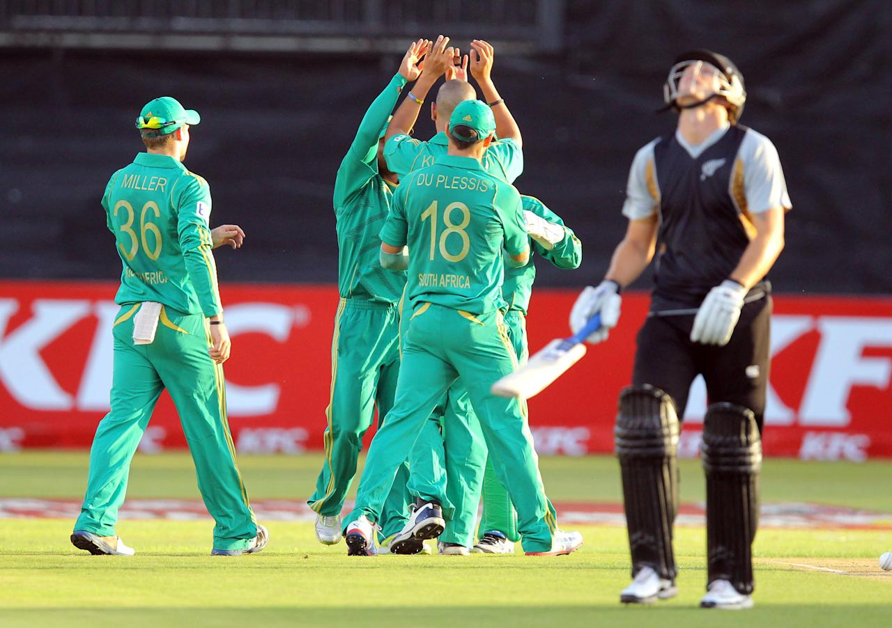 DURBAN, SOUTH AFRICA - DECEMBER 21:   South Africa celebrates the wicket of Rob Nicols of New Zealand during the 1st T20 match between South Africa and New Zealand at Sahara Park Kingsmead on December 21, 2012 in Durban, South Africa.  (Photo by Anesh Debiky/Gallo Images/Getty Images)