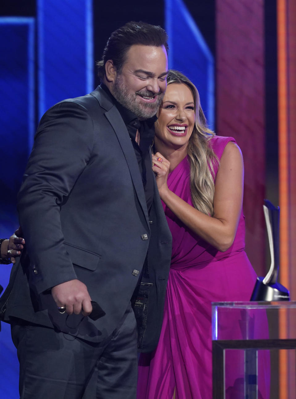 """Lee Brice, left, and Carly Pearce accept the award for single of the year for """"I Hope You're Happy Now"""" at the 56th annual Academy of Country Music Awards on Sunday, April 18, 2021, at the Grand Ole Opry in Nashville, Tenn. (AP Photo/Mark Humphrey)"""