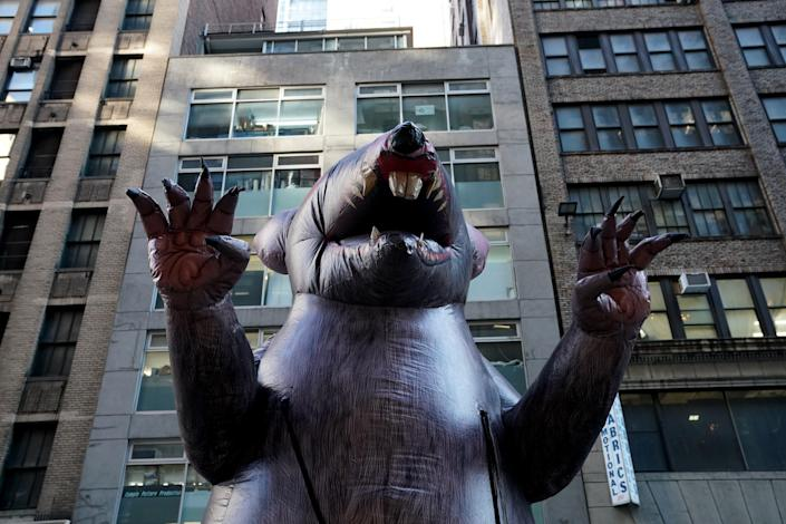 Giant inflatable rats ubiquitous at work sites with labour disputes survived a Trump-era legal challenge at the National Labor Relations Board on 21 July. (AFP via Getty Images)