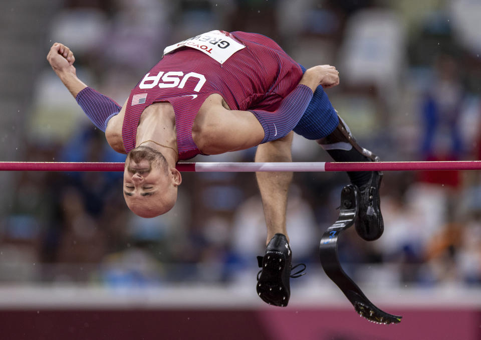 USA's Sam Grewe competes in the Men's High Jump T63 Athletics Final during the Tokyo 2020 Paralympic Games in Tokyo, Tuesday, Aug. 31, 2021. (Simon Bruty for OIS via AP)