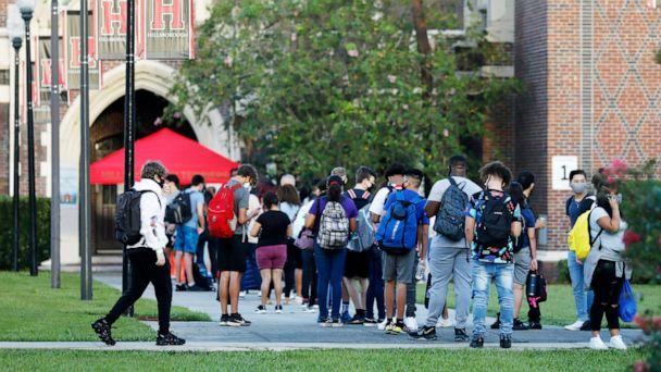 PHOTO: Students at Hillsborough High School wait in line to have temperature checked before entering the building on Aug. 31, 2020, in Tampa, Fla. (Octavio Jones/Getty Images)