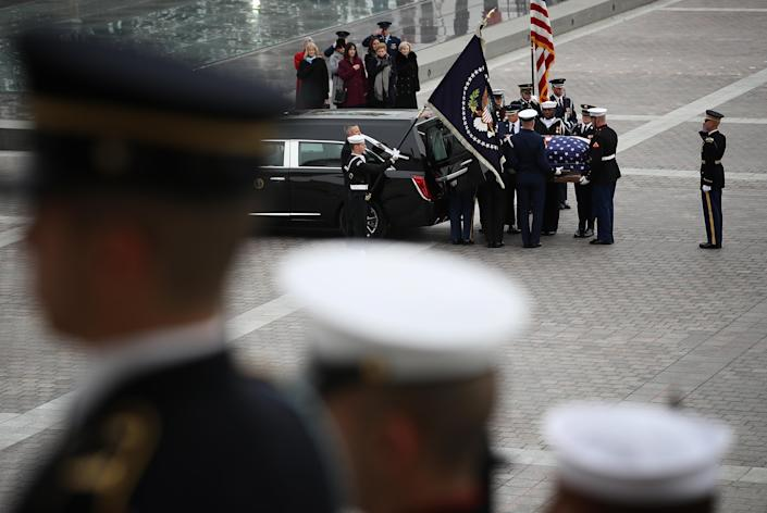 Joint services military honor guards place the casket of former President George H.W. Bush into a hearse in Washington, D.C., on Wednesday, Dec. 5, 2018. (Photo: Win McNamee/Pool via Bloomberg/Getty Images)