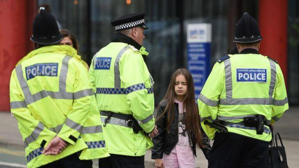 PHOTO: Police talk to people affected by the explosion at Manchester Arena in Manchester, England, May 23, 2017. (Oli Scarffoli/AFP/Getty Images)