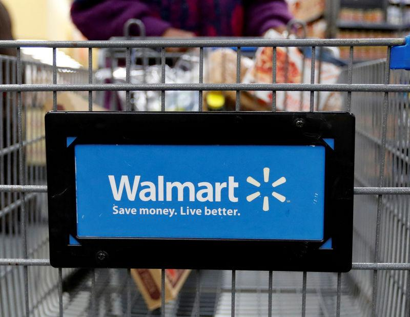 FILE PHOTO: A customer pushes a shopping cart at a Walmart store in Chicago