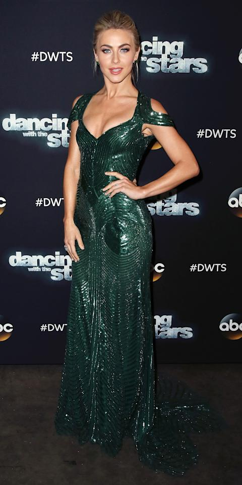 <p>Julianne Hough gave us major va va voom in this glimmering floor length gown with shoulder cut outs and intricate bead detailing. She scaled back on the accessories, keeping the focus on the dress.</p>