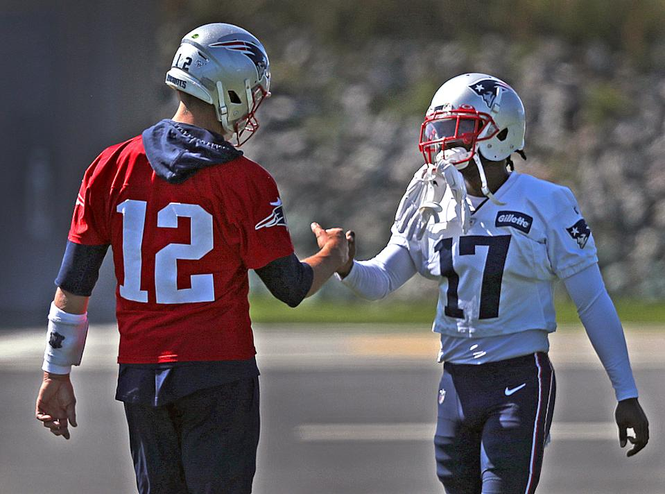 New England Patriots quarterback Tom Brady greets Antonio Brown (17) at a practice during Brown's short stay with the Patriots. (Getty Images)