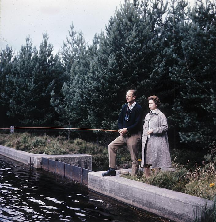 Queen Elizabeth II and Prince Philip fishing at Balmoral on the their 25th wedding anniversary.