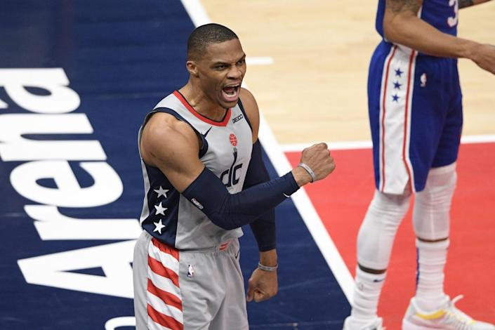 Washington Wizards guard Russell Westbrook reacts after he scored and was fouled.
