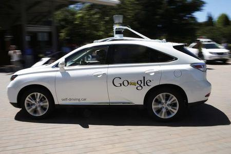 A Google self-driving vehicle drives around the parking lot at the Computer History Museum after a presentation in Mountain View, California
