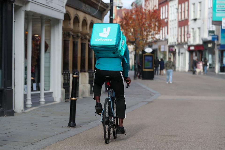 Deliveroo rider cycles along Worcester High Street (PA)