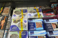 Imported frozen shrimps are displayed at a supermarket in Beijing, Friday, Nov. 20, 2020. China has stirred controversy with claims it has detected the coronavirus on packages of imported frozen food. (AP Photo/Ng Han Guan)