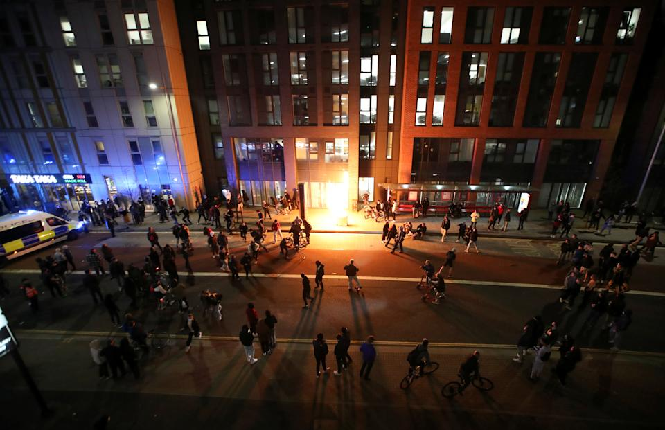 <p>A bin explodes after being set on fire during a protest against a new proposed policing bill, in Bristol, Britain, March 21, 2021. REUTERS/Peter Cziborra</p>