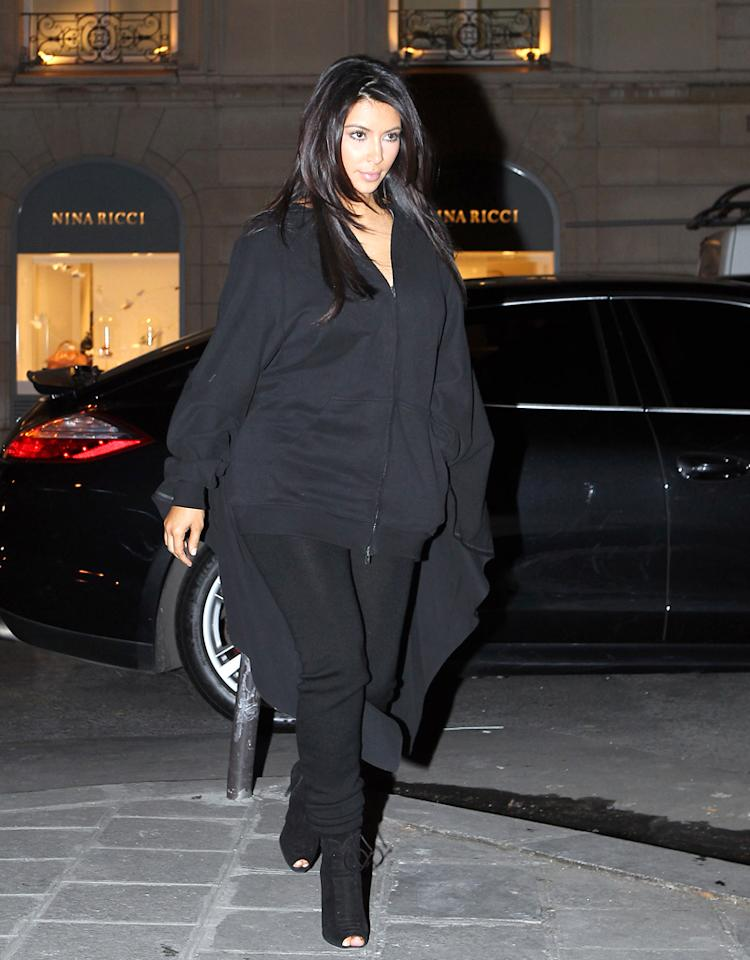 Kim Kardashian and Kanye West are in love in Paris, France. They shopped at Lanvin and Celine before having dinner at l'Avenue Restaurant.