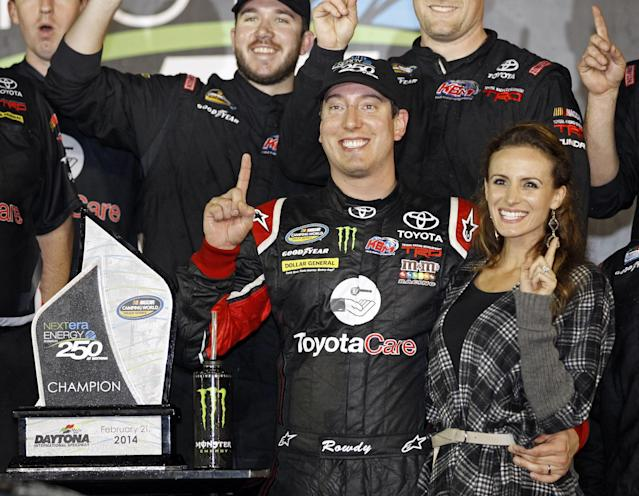 Kyle Busch celebrates in Victory Lane with his wife, Samantha, right, after winning the NASCAR Truck Series auto race at Daytona International Speedway in Daytona Beach, Fla., Friday, Feb. 21, 2014. (AP Photo/Terry Renna)