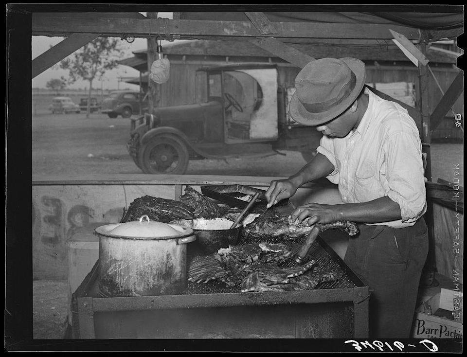 Man slicing barbecue at the Gonzales County Fair, 1939. Photograph by Russell Lee. Library of Congress.