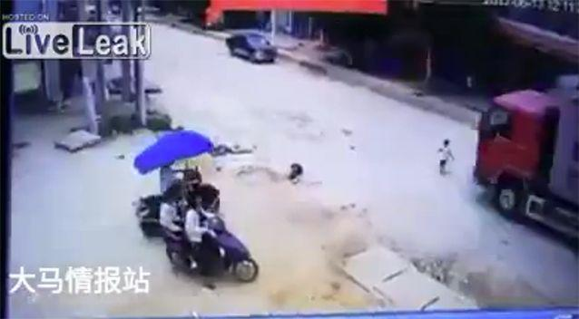 The little boy came face to face with the big truck. Source: LiveLeak