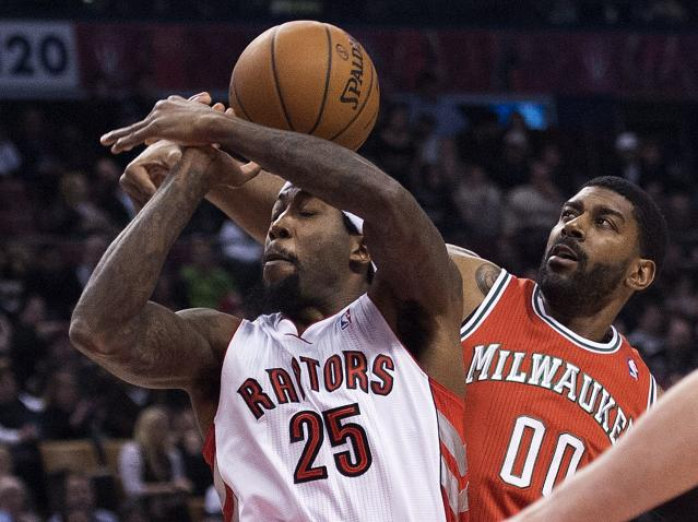 Toronto Raptors forward John Salmons (25) gets the ball stripped by Milwaukee Bucks guard O.J. Mayo, right, during first half NBA basketball game in Toronto, Monday, Jan. 13, 2014. (AP Photo/The Canadian Press, Nathan Denette)