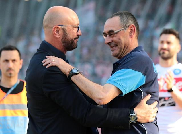Meeting of minds: Napoli coach Maurizio Sarri (right) greets Crotone boss Walter Zenga on Sunday (AFP Photo/CARLO HERMANN)