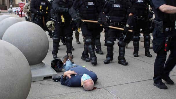 PHOTO: Martin Gugino, a 75-year-old protester, lays on the ground after he was shoved by two police officers, during a protest against the death in Minneapolis police custody of George Floyd, in Buffalo, New York's Niagara Square on June 4, 2020. (Stringer/Reuters)