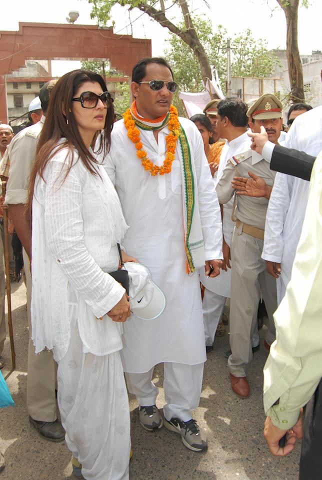 Former Indian cricketer and Congress candidate Mohammad Azharuddin (2L) and his wife, former Miss India and actress, Sangeeta Bijlani (L) are pictured prior to Azharuddin filing his nomination in the upcoming elections in Moradabad on April 21, 2009. India is holding its 15th parliamentary general elections in five phases on April 23, April 30, May 7 and May 13 and the new parliament will be constituted before June 2. AFP PHOTO/ STR (Photo credit should read STR/AFP/Getty Images)