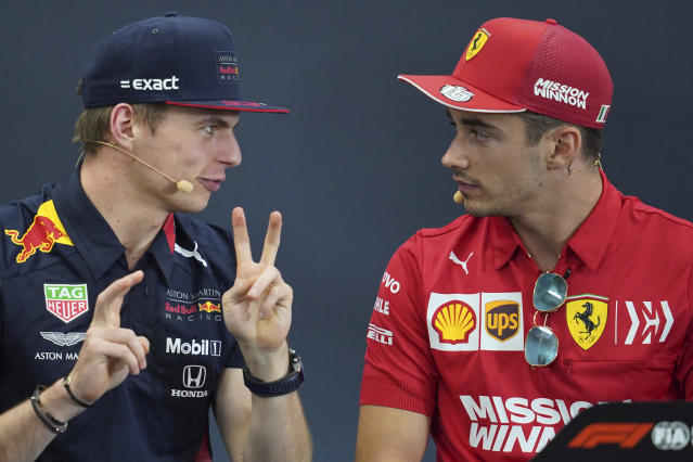 Red Bull driver Max Verstappen of the Netherlands gestures to Ferrari driver Charles Leclerc of Monaco during a press conference for the Japanese Formula One Grand Prix at Suzuka Circuit in Suzuka, Thursday, Oct. 10, 2019. (AP Photo/Toru Hanai)