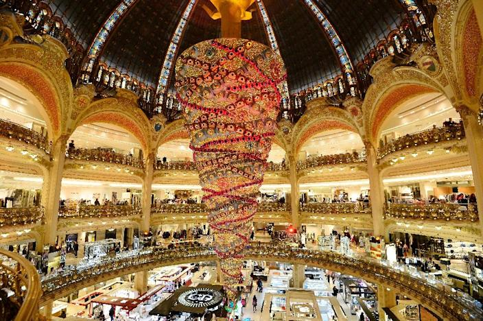 Shops in Paris tourist zones would be able to open every Sunday under proposed new legislation (AFP Photo/Bertrand Guay)