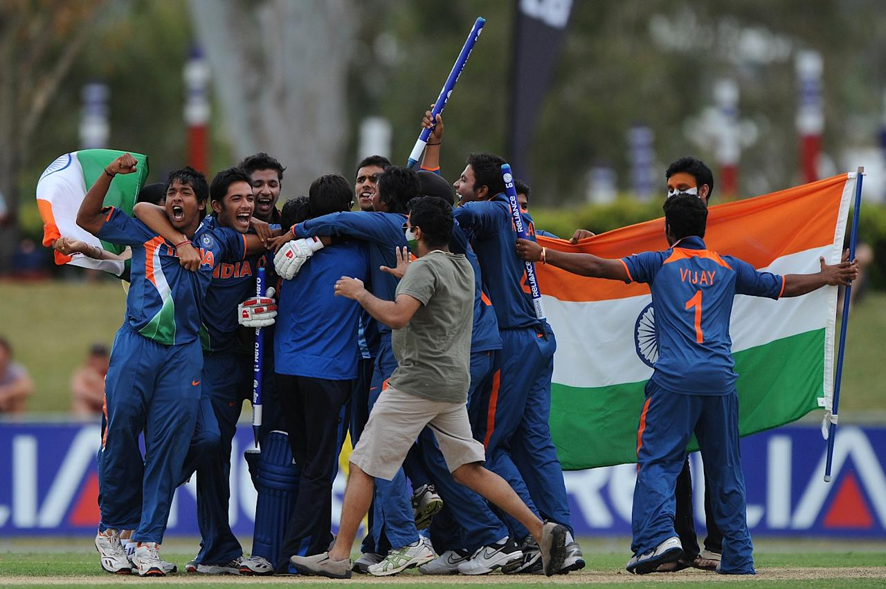 TOWNSVILLE, AUSTRALIA - AUGUST 26:  Players of India celebrate victory after the 2012 ICC U19 Cricket World Cup Final between Australia and India at Tony Ireland Stadium on August 26, 2012 in Townsville, Australia.  (Photo by Matt Roberts/Getty Images)